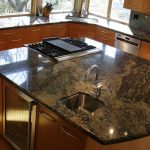 large kitchen island with attached sink and stove
