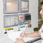 man working with machine