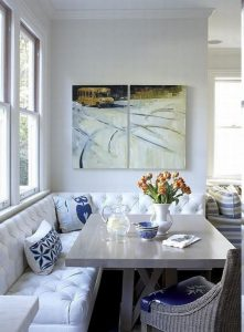Beautiful Banquette Seating with a white couch
