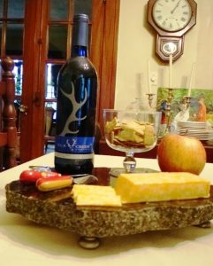 Granite remnant serving tray with wine and cheese