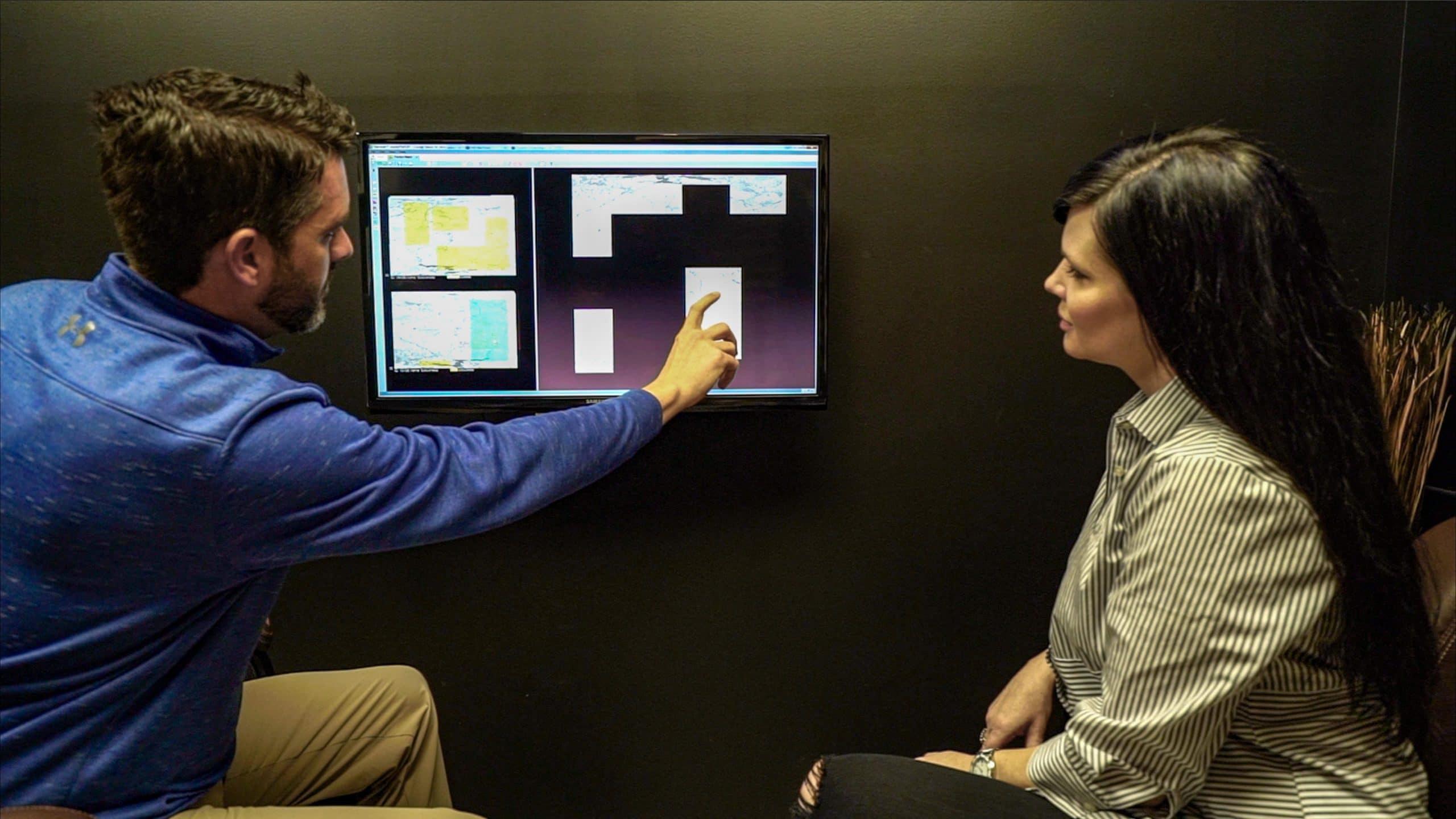 man and woman looking at CAD drawing of countertops
