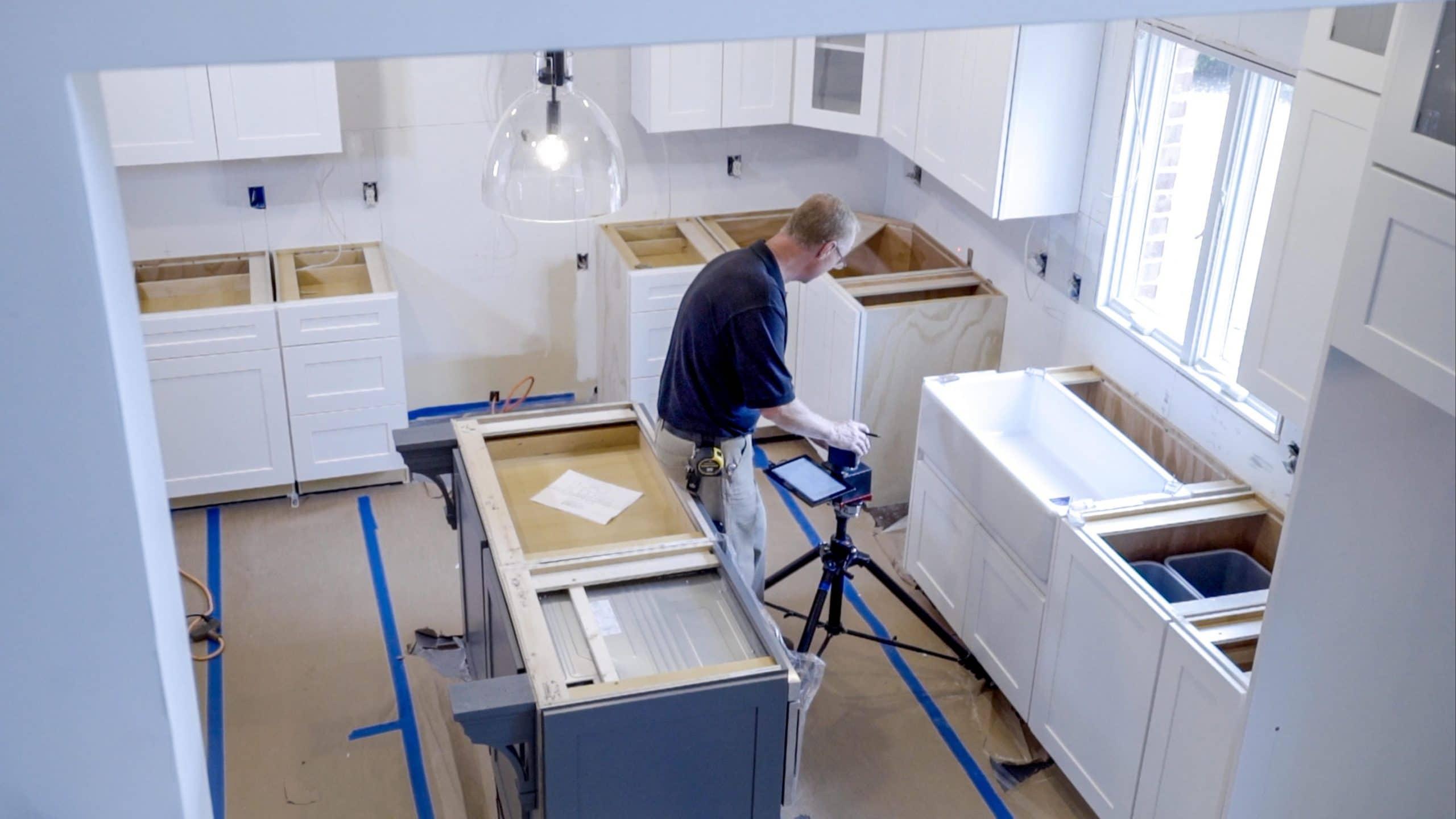 man installing countertops